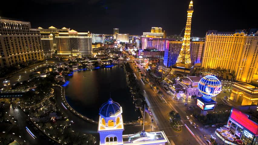 Las Vegas - January 2014: Time lapse illuminated Bellagio Hotel fountain Eiffel Tower Caesars Palace Las Vegas Blvd, Nevada, USA | Shutterstock HD Video #6714025
