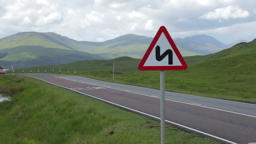 LOCH GARRY, ARGYLL & BUTE/SCOTLAND - JUNE 09, 2014: Holiday traffic drives along A87 road in the countryside in Scotland. Narrow roads are dangerous in the Scottish highlands.  - HD stock footage clip