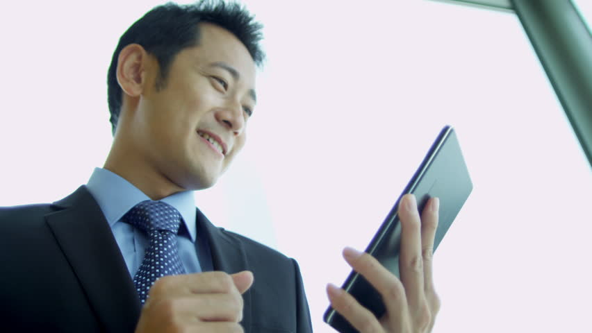 Asian Chinese Male Advertising Executive Wireless Tablet Standing ...