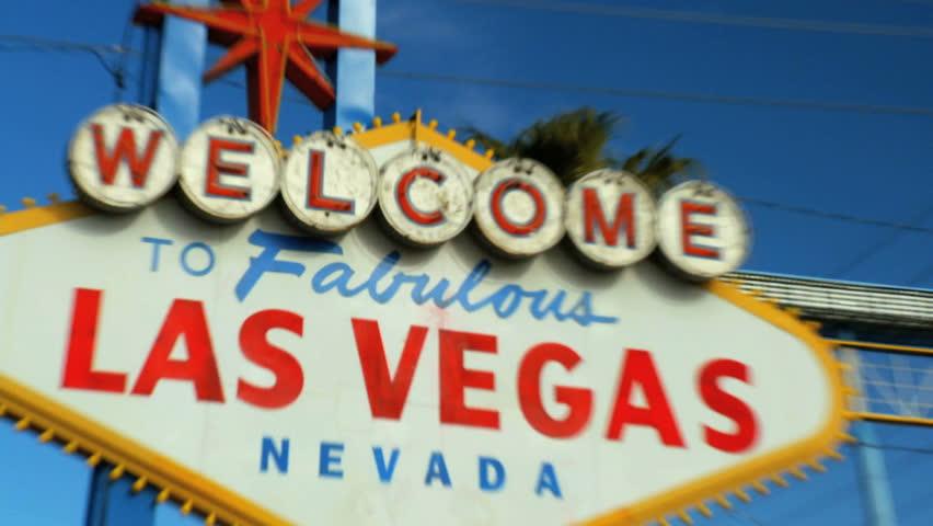 Crash zoom of famous illuminated Las Vegas welcome sign