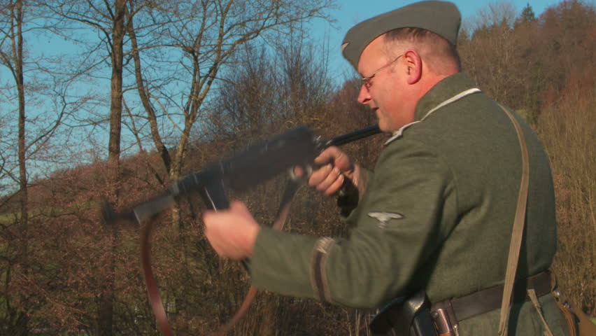 World War 2. German soldier loading and aiming MP 40. - HD stock footage clip