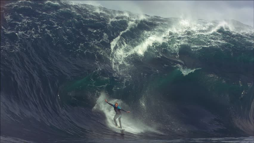 Surfer Mark Mathews Australia 2011. Surfer falls on a huge very difficult wave to surf.