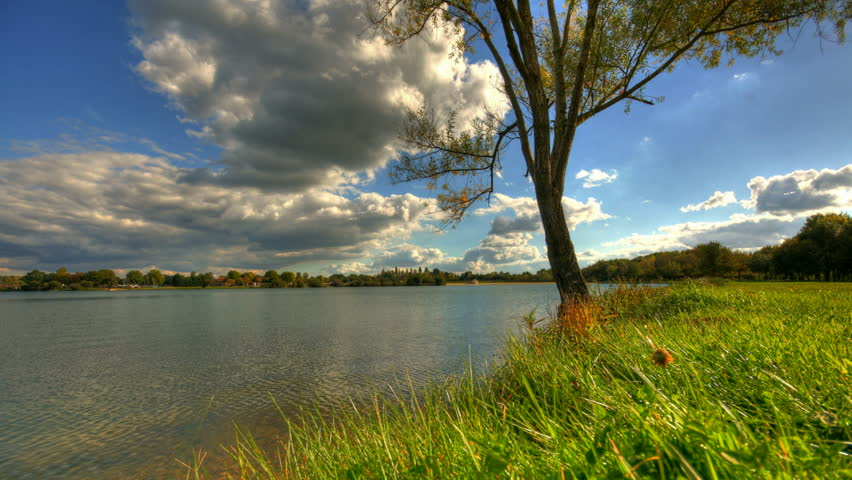 Summer clouds over lake and tree, hd motion control time lapse clip, high dynamic range imaging