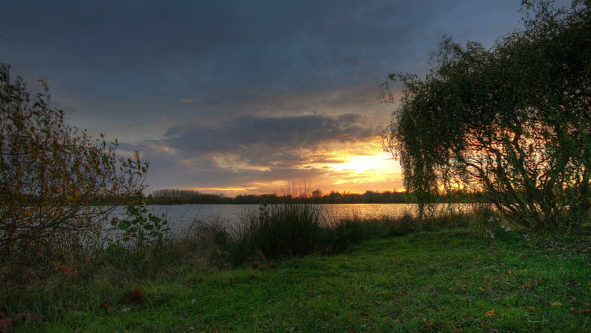 Sunset over lake with trees in the foreground, hd motion control time lapse clip, high dynamic range imaging