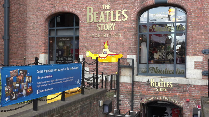 LIVERPOOL, MERSEYSIDE/UK - JUNE 30, 2014: The Beatles Story tourism sign at The Albert Dock. Liverpool was the birthplace of The Beatles.