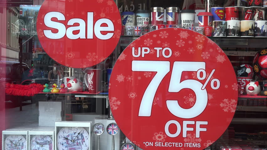 LIVERPOOL, MERSEYSIDE/UK - JUNE 30, 2014: Sale discount sign in shop window. Many shops offer discounts to attract customers during the recession.