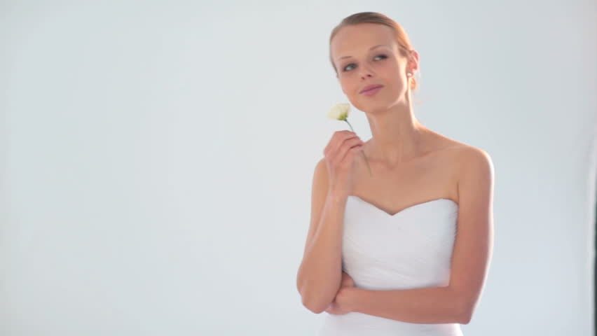 Portrait of gorgeous bride on her wedding day smiling and dancing slowly - HD stock footage clip