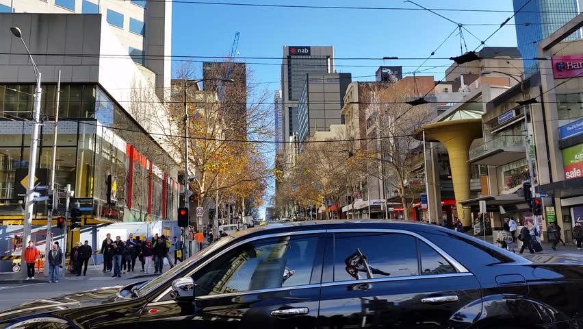 Melbourne City Victoria Australia.  Establishing shot of bustling metropolitan city of Melbourne City Victoria Australia know for it's architecture the Yarra river, Flinders Street station & trams.
