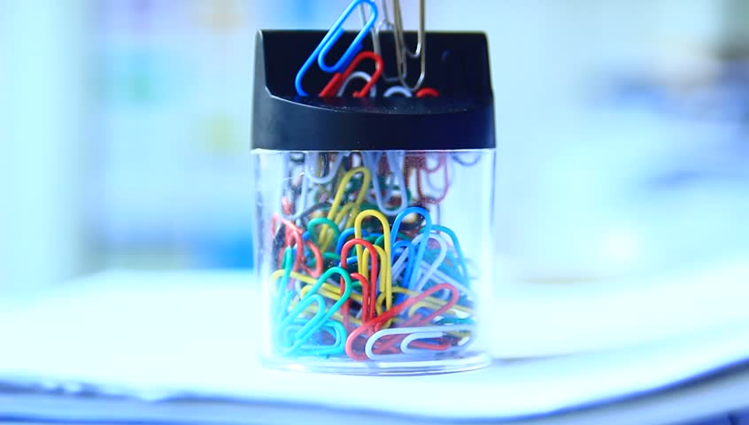Taking paper clips out of the box in the office. | Shutterstock HD Video #6829918