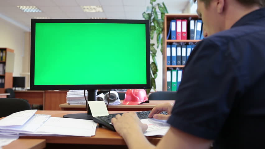 Caucasian worker typing on keyboard and looking at green screen | Shutterstock HD Video #6830044