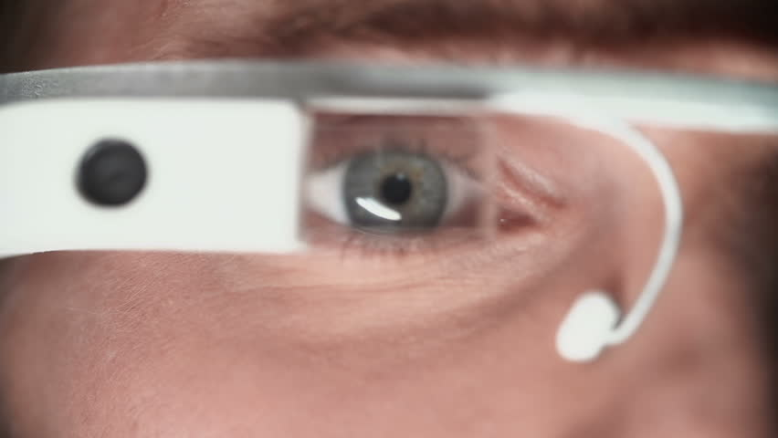 Extreme close up of male eyes in smart glasses - HD stock video clip