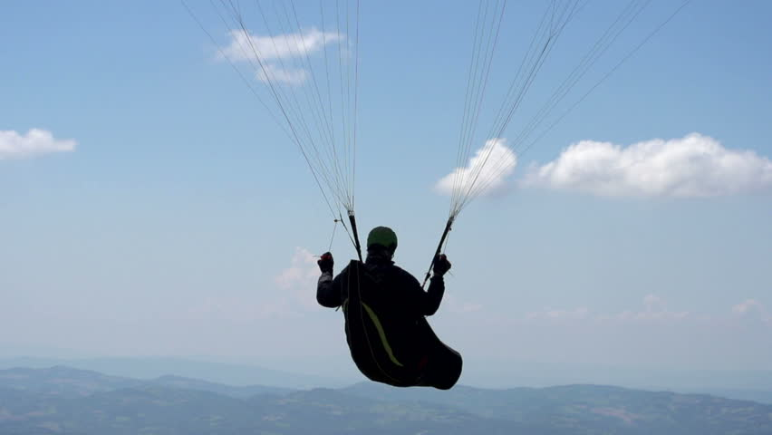 Slow Motion Paragliding Flight Silhouette - HD stock video clip
