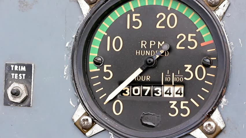 Hour Meters Panel : Mechanical aircraft tachometer and hour meter on a gray