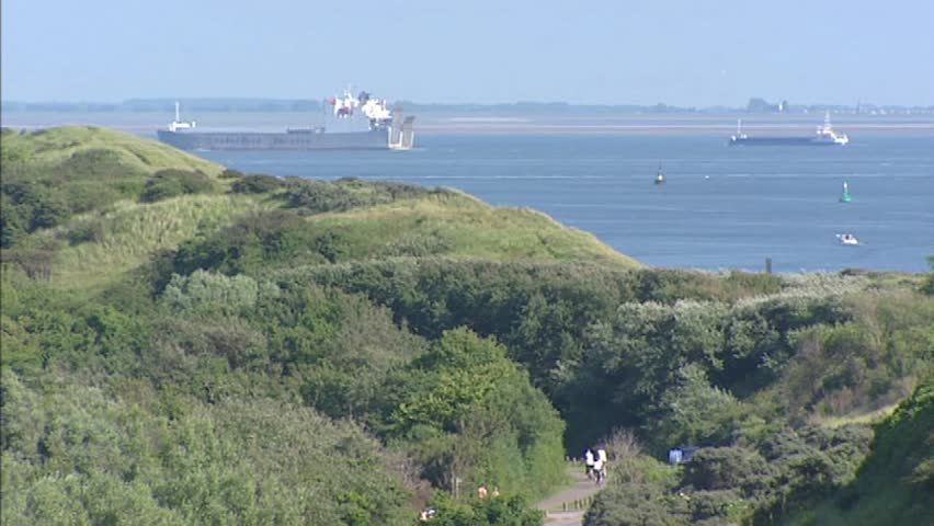 View from dune crest at the Western Scheldt (Westerschelde) estuary near Koudekerke, The Netherlands. The Western  Scheldt is an important shipping route to the Port of Antwerp, Belgium.