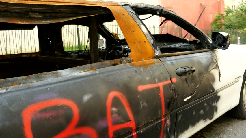 Close up of a burnt white stretched limousine in Paris | Shutterstock HD Video #6914095