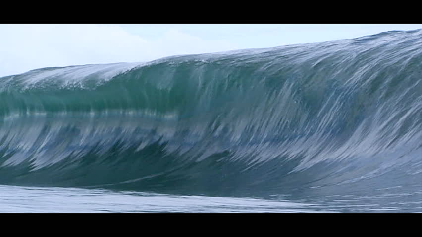 Waves rising and breaking, slow motion, close-up
