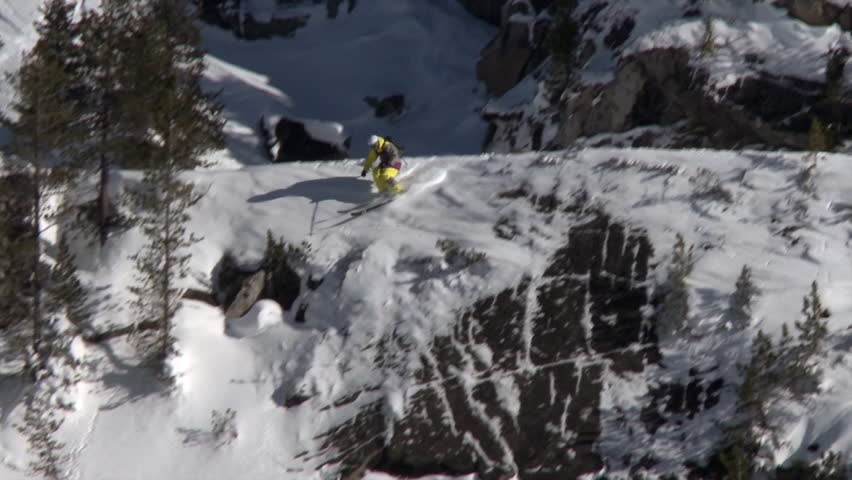 A skier looses his balance and falls