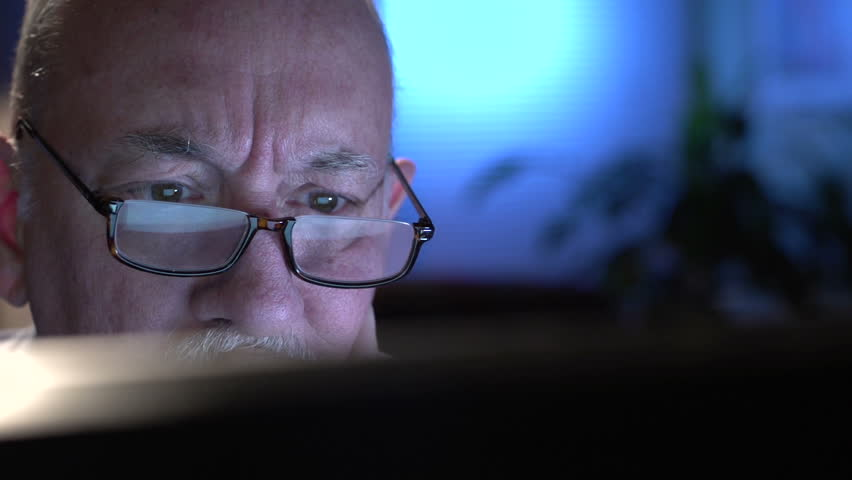 Frustrated older man at computer, close up | Shutterstock HD Video #6921763