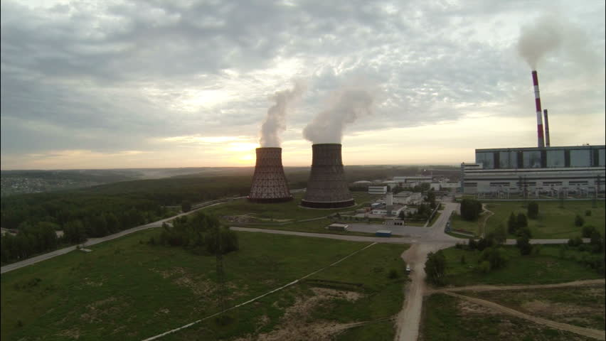 Aerial Footage Fisheye Nuclear Cooling Towers Against Sunrise - HD stock footage clip