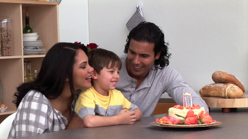 Adorable little boy celebrating his birthday with his parents in the kitchen - HD stock video clip