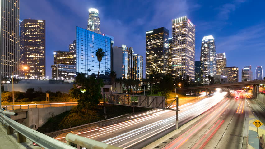 Downtown Los Angeles and freeway traffic at dusk, time lapse.