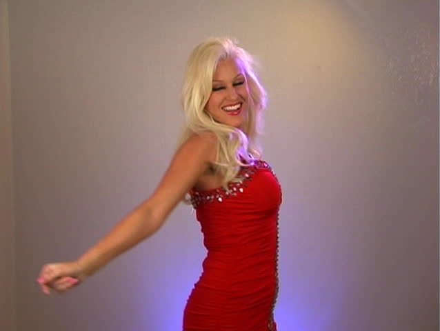 A sexy young blonde dancing in a bright red dress.  - SD stock video clip