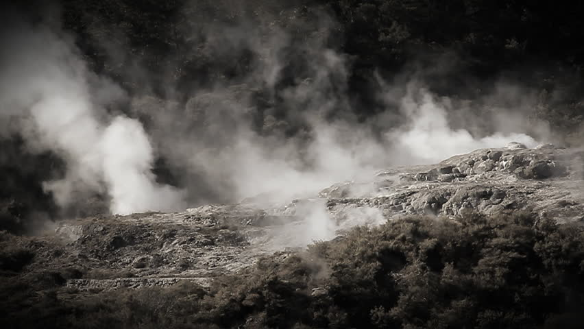 Slow motion. Geothermal area at Rotorua New Zealand. Hot springs, silica terraces, and steaming vents at Whakarewarewa Thermal Park - one of NZs top tourist attractions. Monochrome tinted footage.