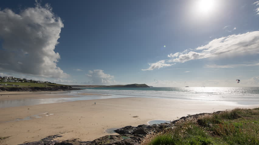4k Beautiful time lapse in  lovely early morning light of polzeath beach in cornwall, england  - 4K stock video clip