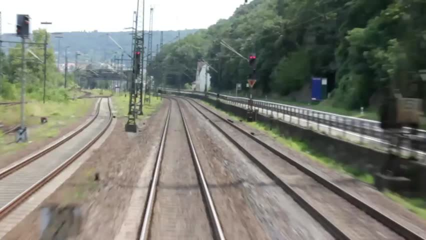Metal rails escape from under the train. Shooting out the back window of the last car - HD stock video clip