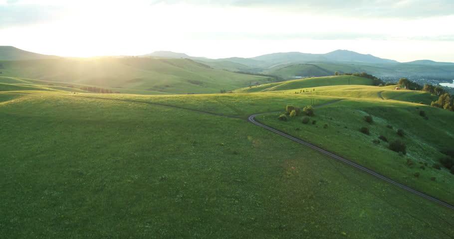 Aerial View. Sunset. Flight over a green grassy hills. Altai Mountains, Siberia, Russia. Summer 2013. 4K resolution. | Shutterstock HD Video #6993538