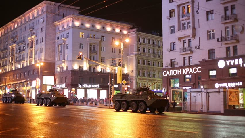 MOSCOW, RUSSIA - MAY 3, 2013: Armored troop-carriers at night rehearsal of Victory Day parade. In May 9 parade will be attended by more than 151 military vehicles, 69 aircraft and helicopters   Shutterstock HD Video #6998209