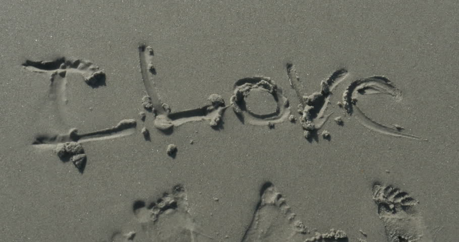 Love Written in the Sand at the Beach - 4K stock video clip