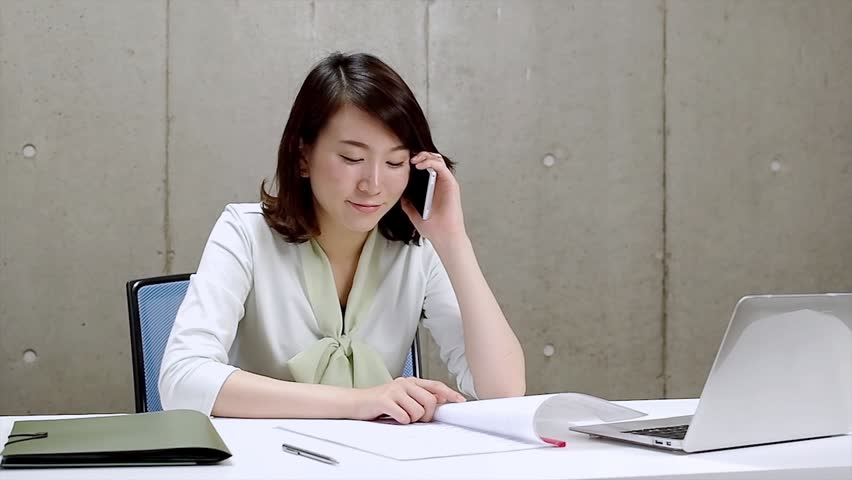 young business woman who checks a document while calling. - HD stock footage clip