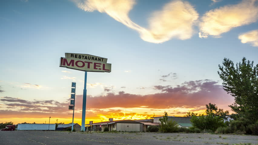 Beautiful sunset behind Restaurant Motel sign - HD stock footage clip