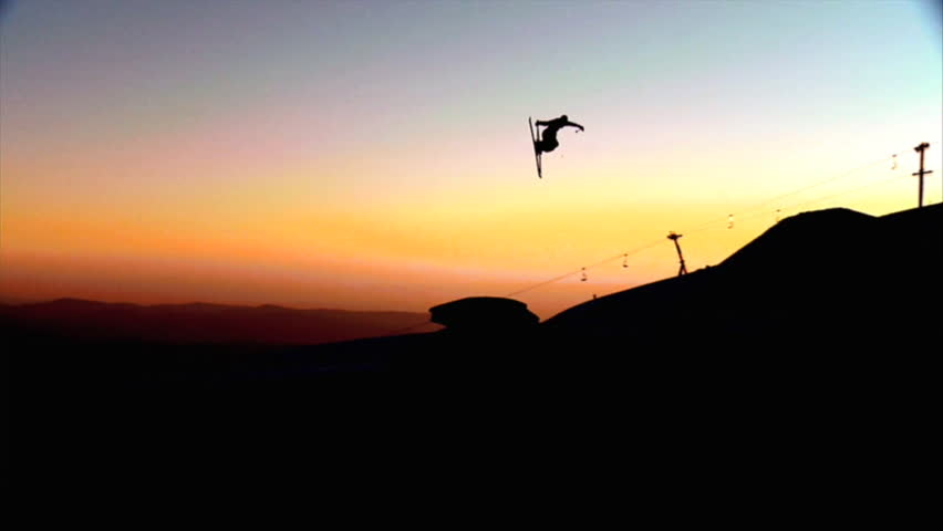 Freestyle skier jumps over a kicker in slow motion during an amazing sunset | Shutterstock HD Video #7047394