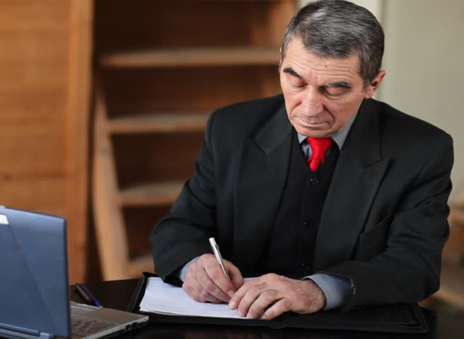Writing businessman  - SD stock video clip