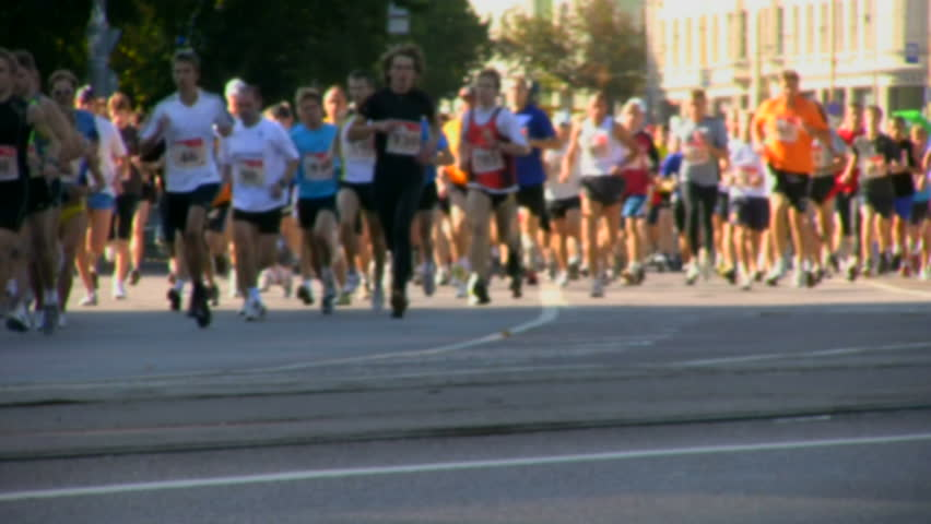 Group of people running in a marathon - HD stock footage clip