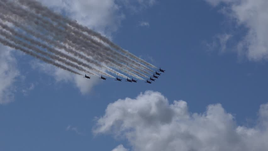 BROOKLANDS, SURREY, ENGLAND - AUGUST 2014 - RAF Red Arrows Aerobatic Display Team fly over Brooklands Clubhouse -  02666698