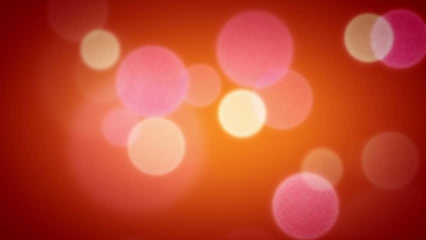 Soft Focus Light Particles Orange. Drifting through lights in soft focus. Seamless Loop.