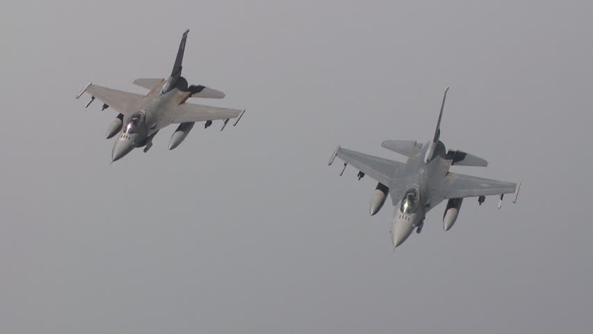 CIRCA 2010s - Two Air Force F-16 jet fighters fly in formation.
