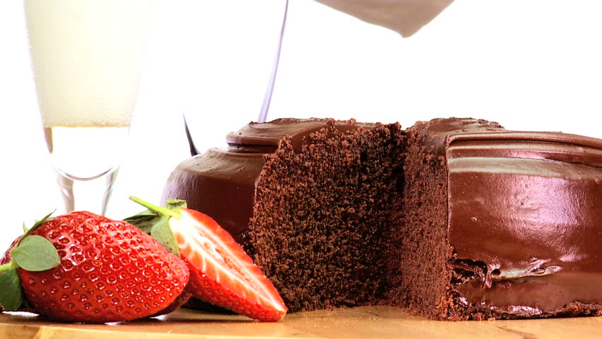 Seductive sticky chocolate cake served with fresh strawberries & sparkling white wine - HD stock footage clip