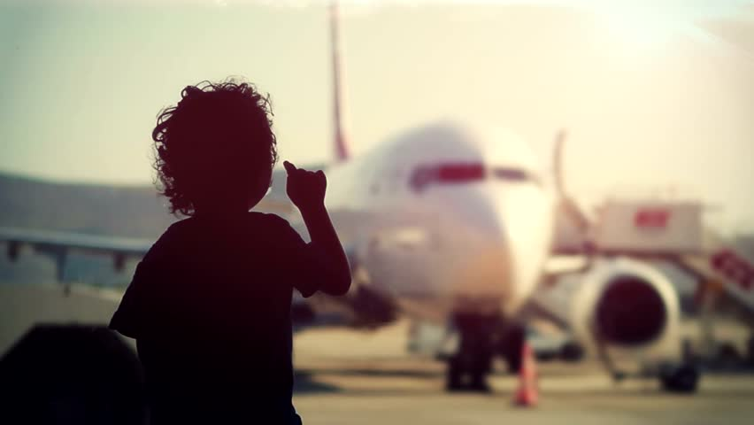 Little boy at the airport terminal.
