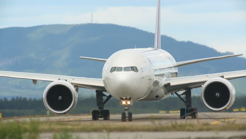 THAI AIRWAYS BOEING 777 AT OSLO AIRPORT NORWAY - CA JUNE 2014: This is one of the largest airplanes frequenting the airport for passenger transportation