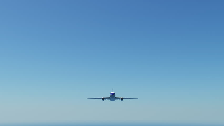 Airplane flying in blue sky.