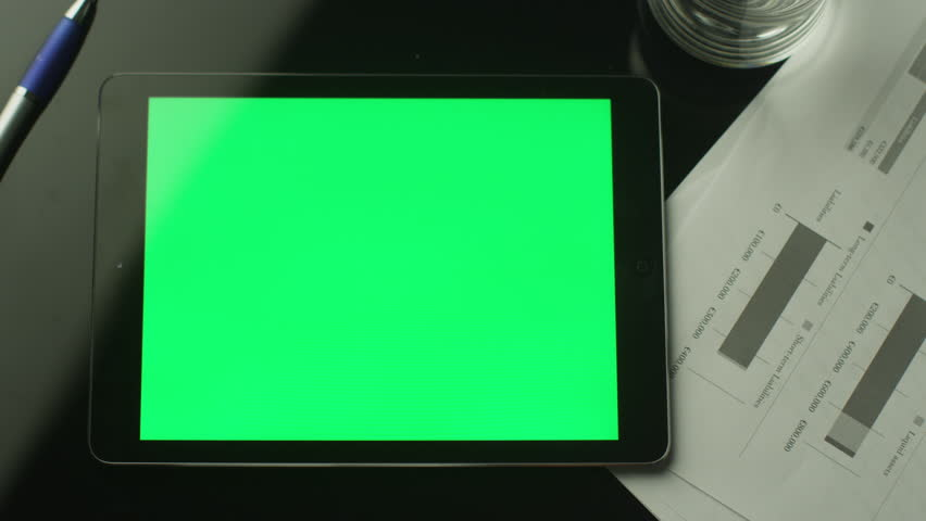 Businessman Using Tablet PC with Green Screen which Lying on the Table. Top view. Shot on RED Cinema Camera in 4K. ProResHQ codec - Great for editing, color correction. #7157374
