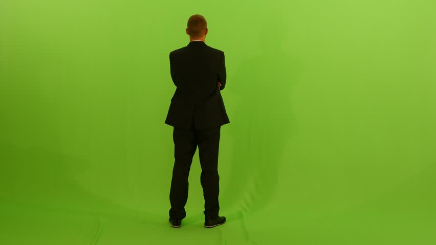 man walking against green screen. male person isolated. watching looking. view. casual dressed. business - 4K stock video clip