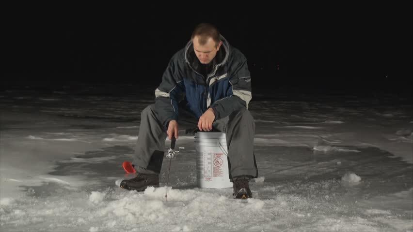 Man ice fishing at night on frozen lake 5 stock footage for Ice fishing at night