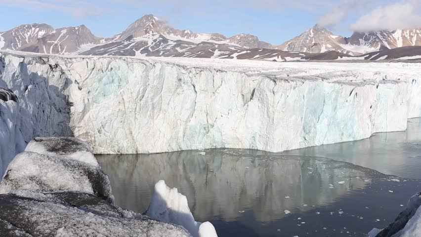 Tidewater glacier calving into the fjord - Arctic, Spitsbergen