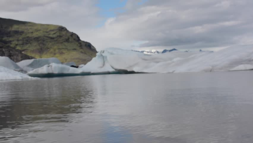 First person view from a tourist zodiac boat moving fast in glacier lagoon Fjallsárlón, near ice lagoon Jökulsárlón, Iceland | Shutterstock HD Video #7188640