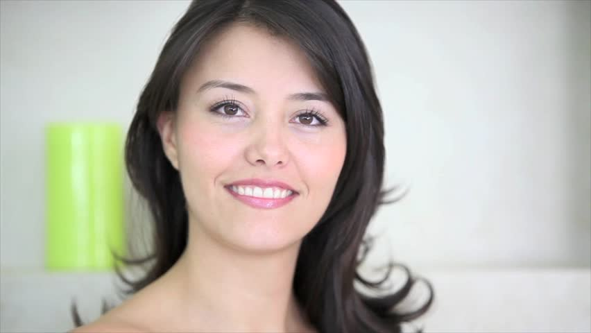 Beauty brunette woman brushing her hair and smiling  - HD stock video clip
